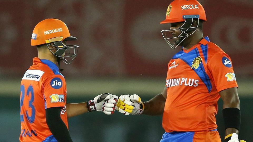 Ishan Kishan and Dwayne Smith of Gujarat Lions celebrate a boundary during the IPL 2017 match against Kings XI Punjab in Mohali on Sunday.