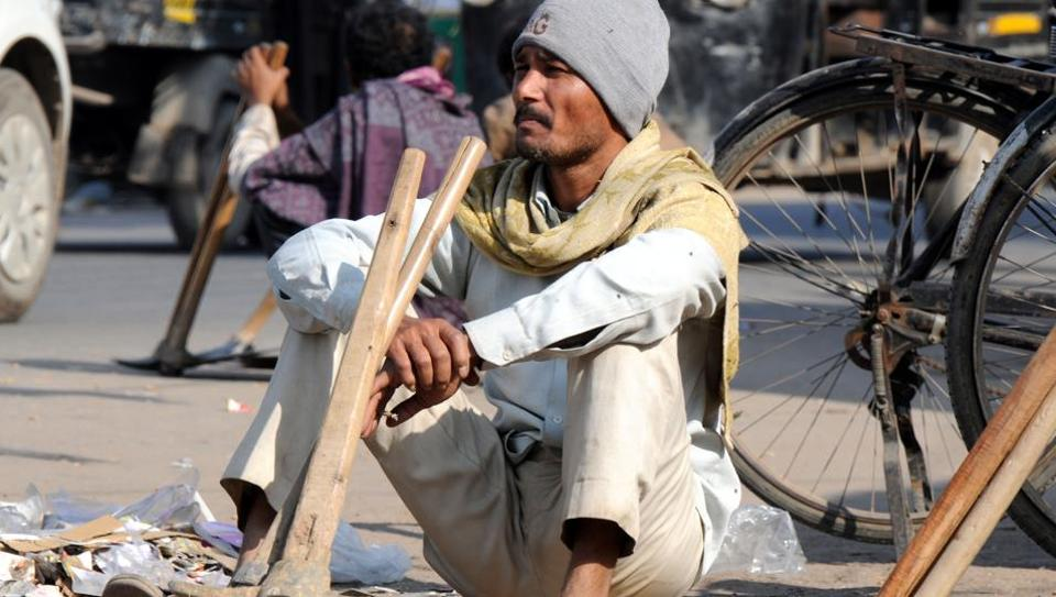Daily wage workers are waiting for work at labour chowk, in Gurgaon. The demonetisation move by the Centre is turning out to be a nightmare for over 1 lakh construction workers in the city.
