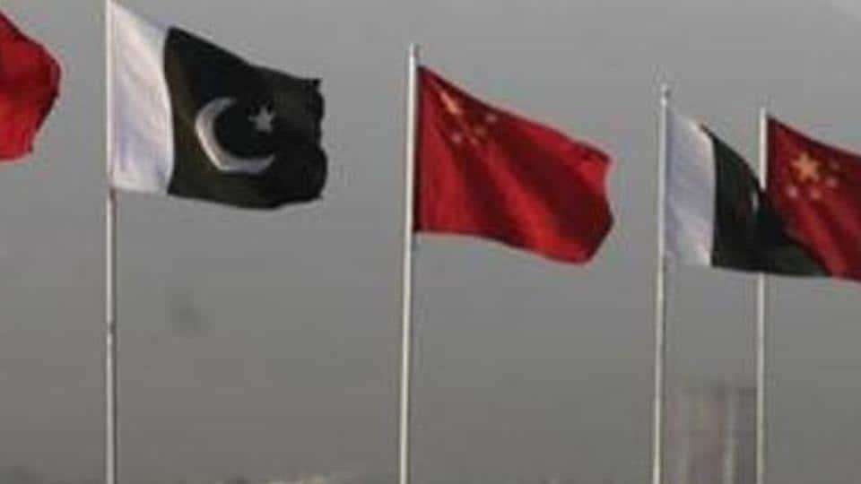 Pakistan and China flags displayed along a road, ahead of Chinese Premier Li Keqiang's visit to Islamabad May 21, 2013.