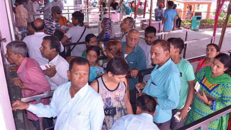 Pilgrims wait for their turn at the registration counters for the Chardham Yatra in Rishikesh