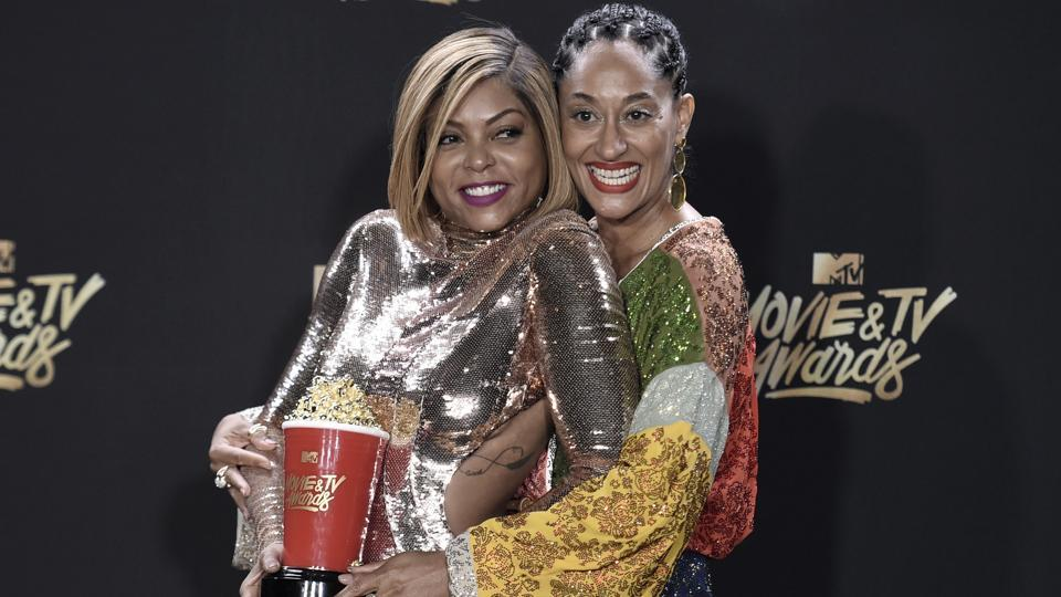 Taraji P. Henson (left) with the award for best fight against the system for Hidden Figures, poses with Tracee Ellis Ross in the press room. (Richard Shotwell/Invision/AP)