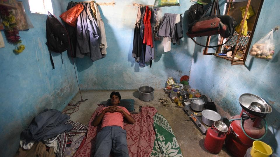 Debendra takes a nap in his one room house that he has rented at Mehrampur villege near the Domestic airport in Delhi. Kapri came to Delhi four years ago from Bihar's Banka district for earning a living as a taxi driver. (Ravi Choudhary/HT PHOTO)