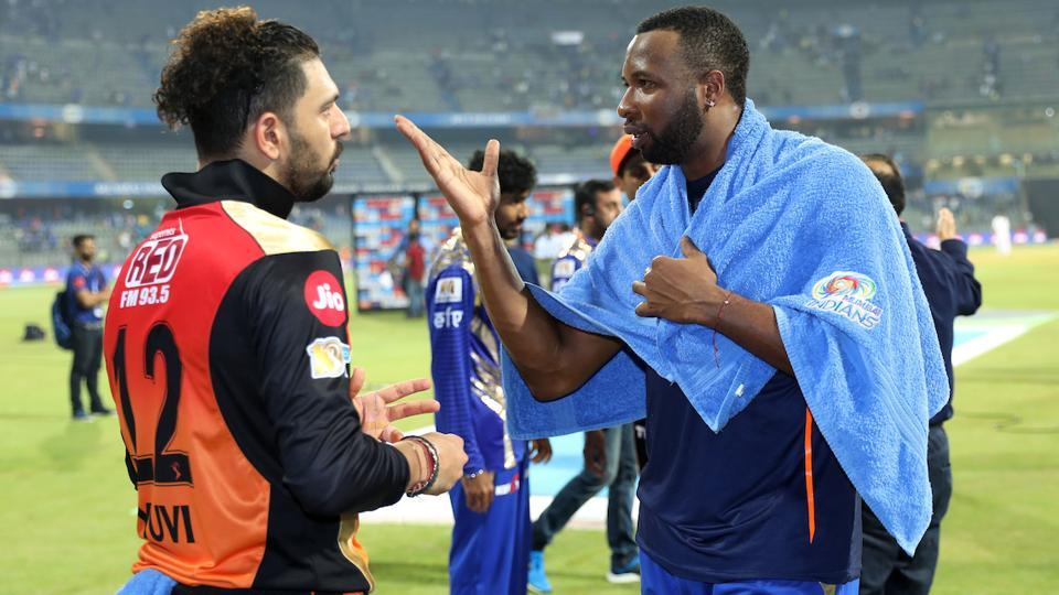Yuvraj Singh of the Sunrisers Hyderabad and Kieron Pollard of the Mumbai Indians chat after their first leg match at the Wankhede Stadium in Mumbai on April 10. The return leg match between SRH and MI will be played today. Get live score of SRH vs MI here.