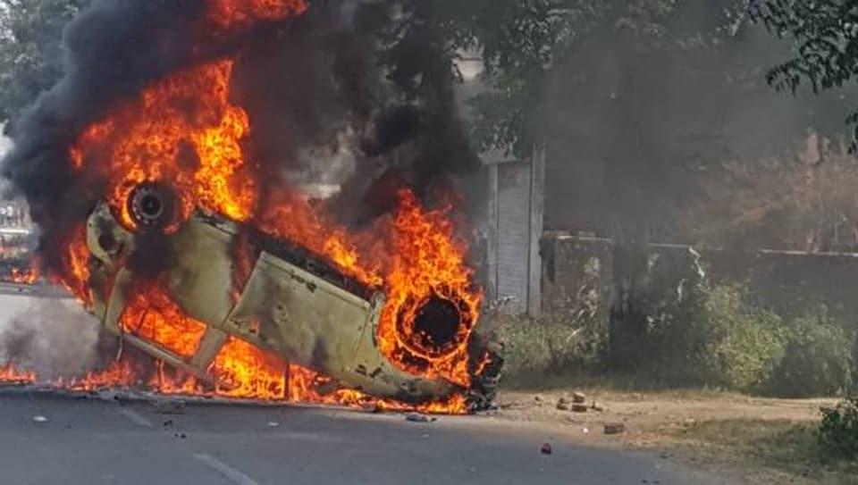 A car set on fire after Dalits clashed with police in Saharanpur, Uttar Pradesh.