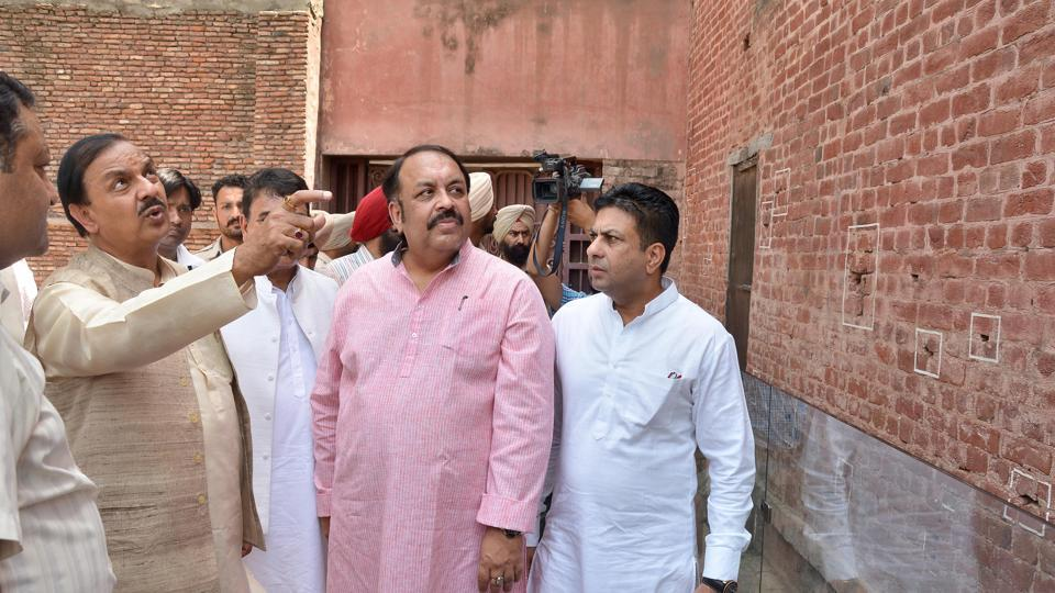 Minister of state (independent charge) culture and tourism Mahesh Sharma (left) with Rajya Sabha MP Shwait Malik (in pink) at the Jallianwala Bagh in Amritsar on Monday.