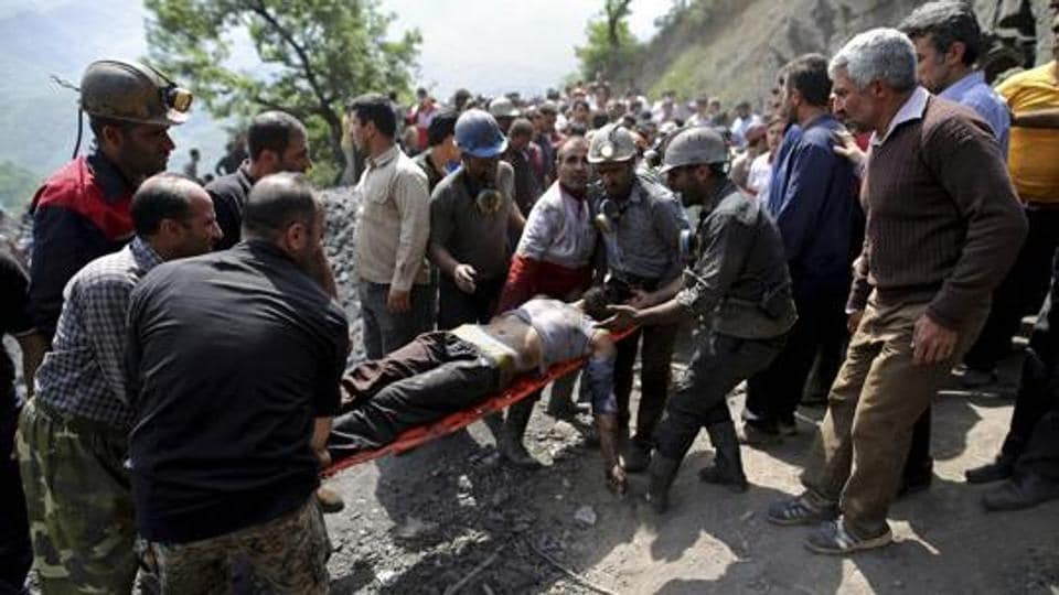 Azadshahr : In this picture released by the Tasnim News Agency, miners and rescue personnel carry an injured mine worker after a coal mine explosion, near Azadshahr in northern Iran, Wednesday, May, 3, 2017.