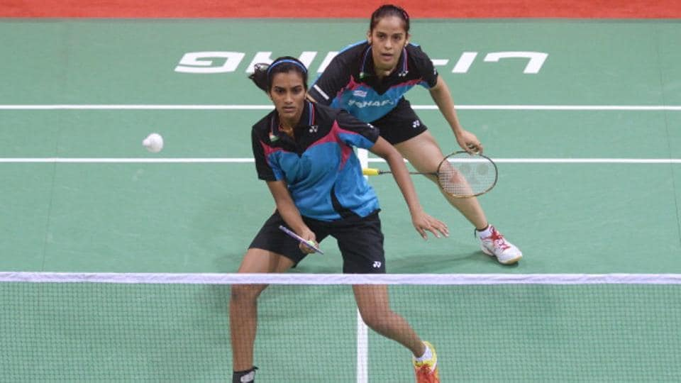 PV Sindhu (L) and Saina Nehwal of India during an Uber Cup badminton match vs Thailand at Siri Fort Stadium in New Delhi on May 20, 2014. Sindhu and Saina teamed up again for a doubles match for their employers Bharat Petroleum