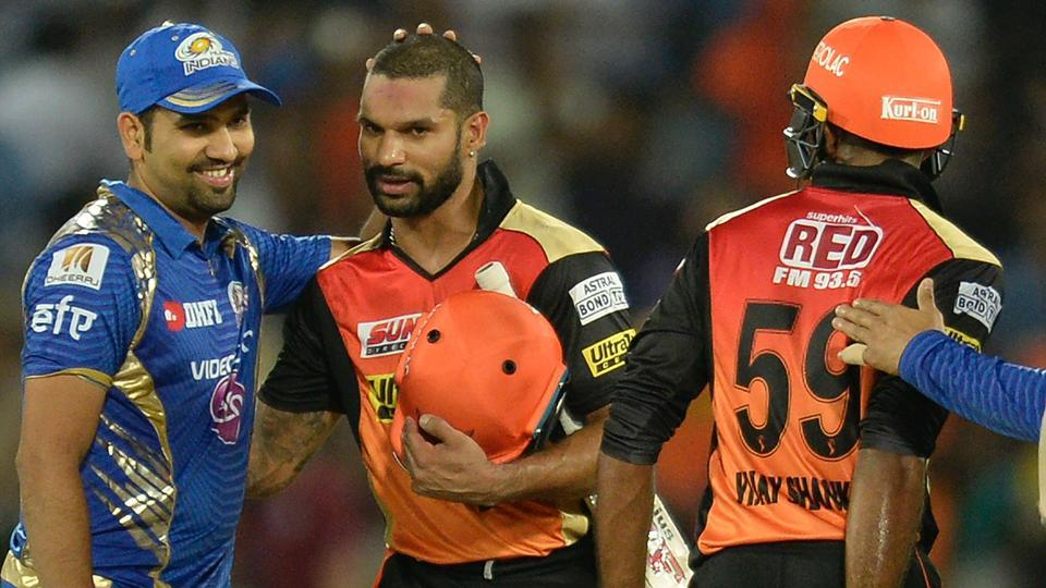 Mumbai Indians (MI) captain Rohit Sharma (L) congratulates Sunrisers Hyderabad's (SRH) Shikhar Dhawan after the latter guided his team to a seven-wicket win in the Indian Premier League (IPL) 2017.