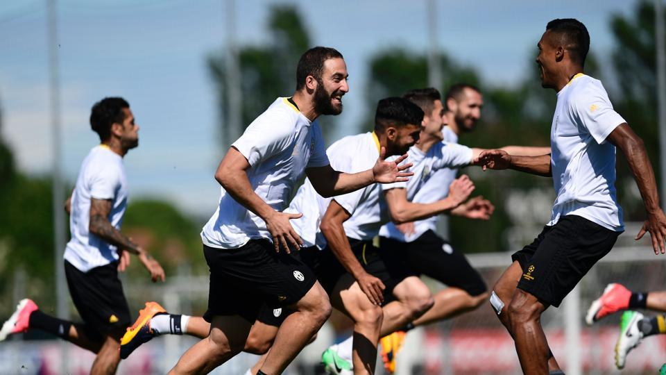 Juventus F.C. forward Gonzalo Higuain (centre) shares a light moment with teammates on the eve of their UEFA Champions League semifinal 2nd leg match against ASMonaco FC at the Vinovo training ground in Turin on Monday.