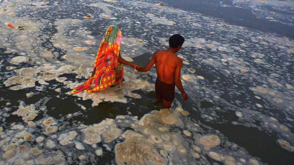 (FILES) People bathing in the polluted river Ganges near Sangam in Allahabad. Lucknow University has announced three new programmes to enable  its students and faculty to get involved in the clean-up of the river.