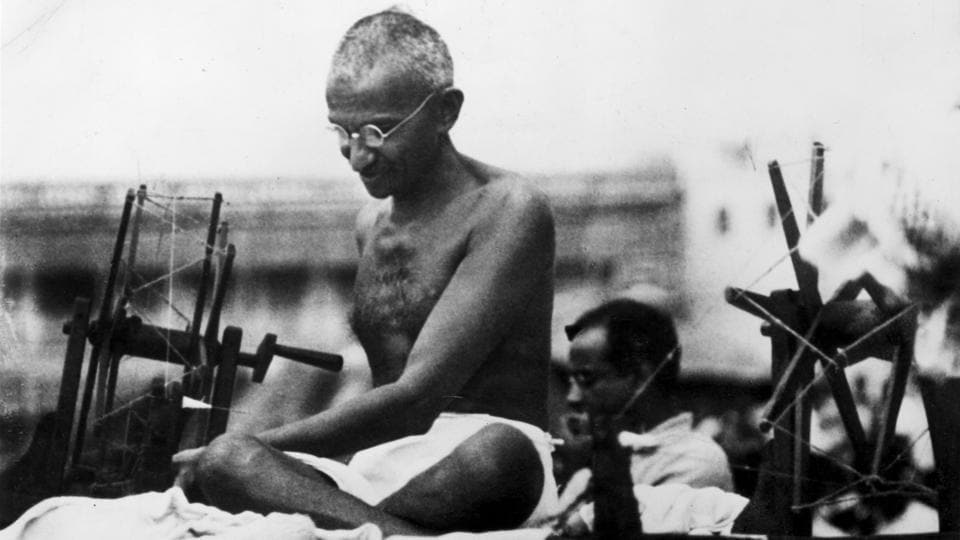 A vintage photograph of Mohandas Karamchand Gandhi, better known as the Mahatma, with his charkha.