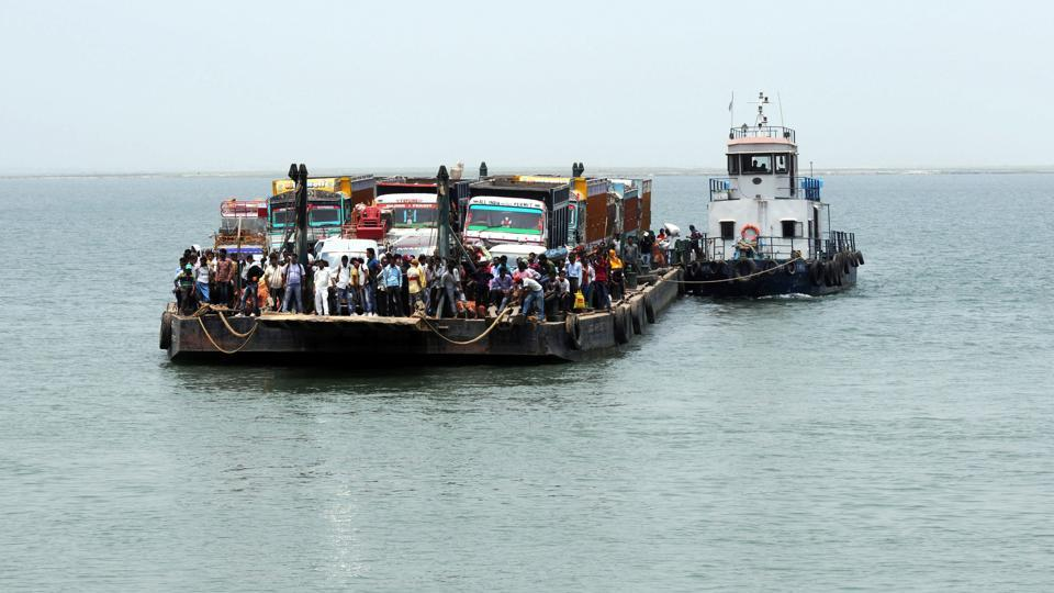 Heavy vehicles of Bihar state crossing the Ganga river through  ship carrier  to enter Jharkhand at Samda Nala Ghat of Sahebgunj District