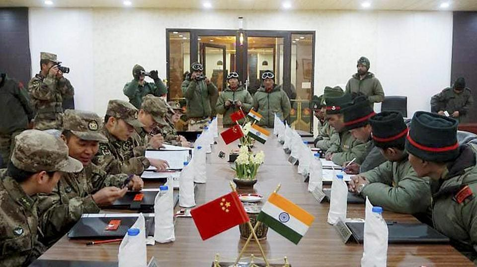 """Indian and Chinese Army soldiers at the Ceremonial Border Personnel Meetings (BPMs) on the occasion of """"Harvest Festival'' at Indian BPM hut in Chushul in Eastern Ladakh."""