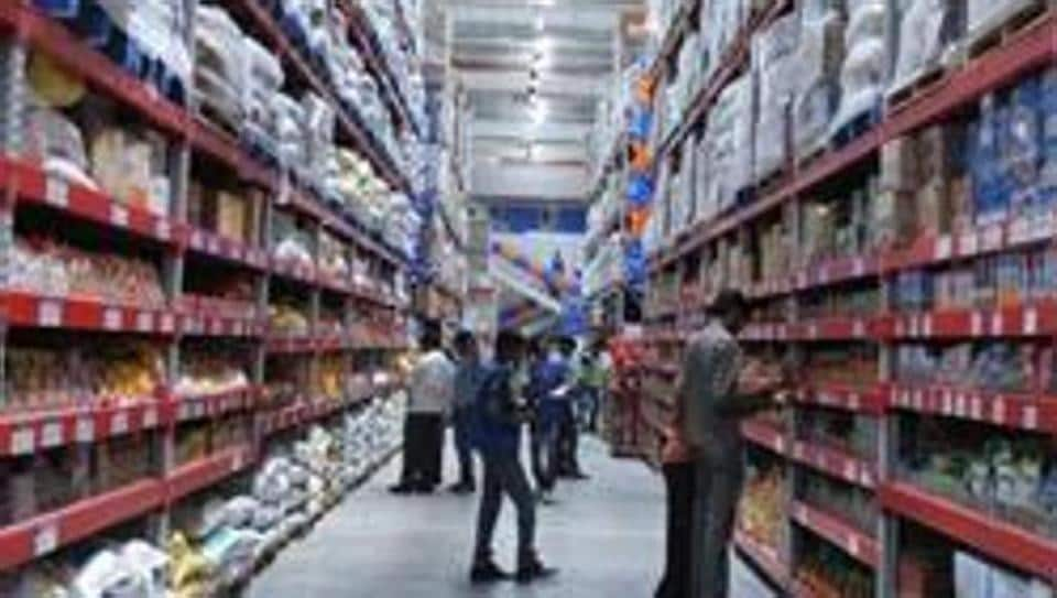 A file picture taken on September 26, 2012 shows Indian shoppers browsing through the products at a store in Hyderabad. An IMF report has said that India's growth is expected to grow at 7.7% in 2018-19 after disruptions caused by demonetisation,
