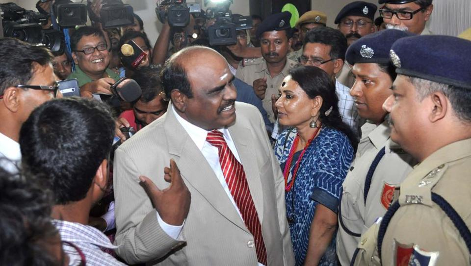 Calcutta high court judge Justice CS Karnan (C) gestures as he speaks with police personnel in Kolkata on May 4, 2017.