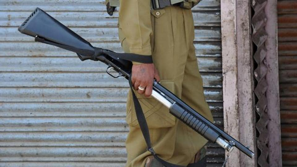 An Indian paramilitary trooper holds a pellet gun in Kashmir in July 2016.
