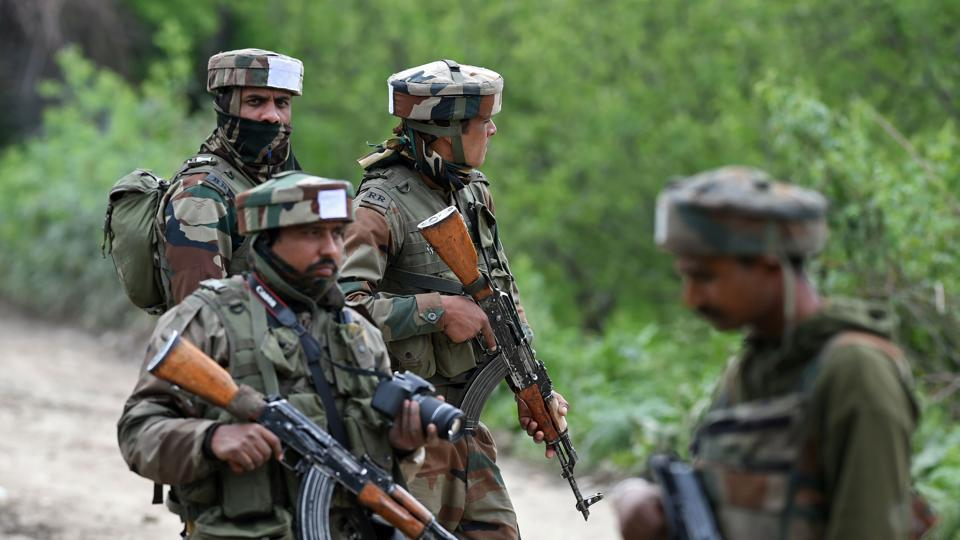 Army soldiers patrol during an operation against suspected rebels in Turkwangam Lassipora in Shopian south of Srinagar.