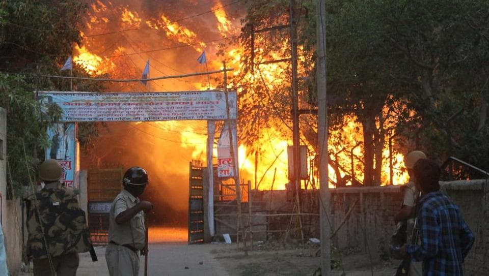 A fire broke out after clashes between police and encroachers who were being evicted from Jawaharbagh in Mathura.