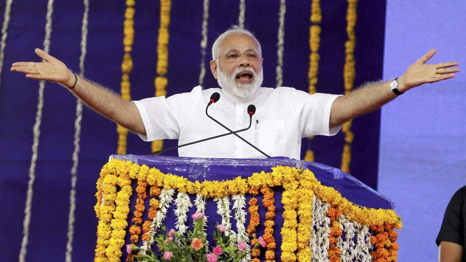 Prime Minister Narendra Modi addresses a gathering at Botad in Gujarat on April 17. Narendra Modi remains such an overwhelmingly dominant figure in Gujarat politics that even after his exit, there is continuity.