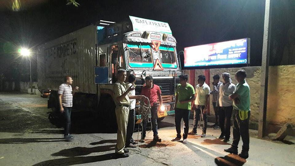 Police officials with the truck in which 21 cows were being transported at Khairthal town in Alwar district of Rajasthan.