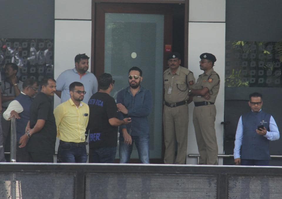 Salman Khan's bodyguard, Shera, who is looking after security of Justin Bieber, checks out the security details at  the VIP gate of the airport on Monday.