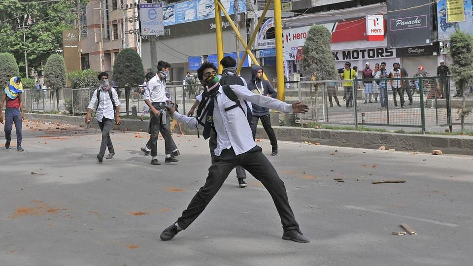 A Kashmiri student throws a stone during clashes with police in Srinagar's Lal Chowk on Tuesday.
