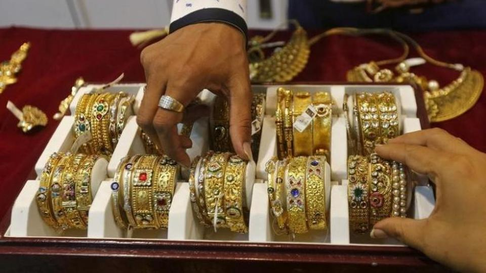 Gold inches up from eight-week low as dollar slides