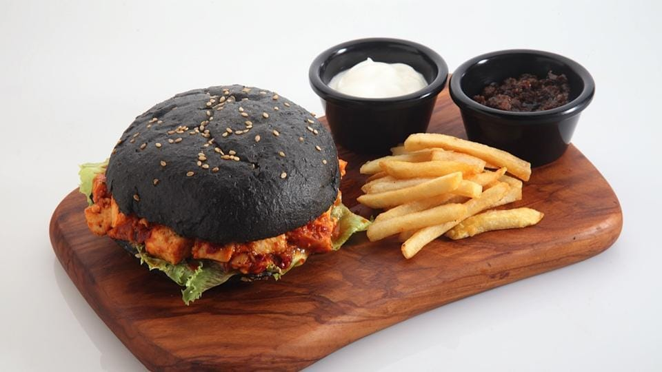The BBQ paneer burger at The Rolling Pin features an activated charcoal bun.