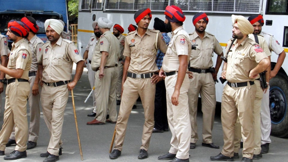Policemen wearing low-waist pants with a tighter fit in Ludhiana on Wednesday.