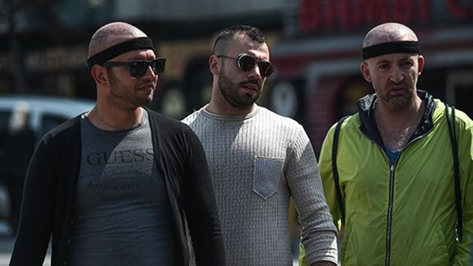 Men at Taksim square after hair transplant surgery.