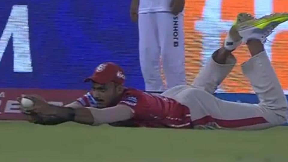 Axar Patel of Kings XIPunjab (KXIP)takes the catch to get rid of Robin Uthappa of Kolkata Knight Riders (KKR)during their Indian Premier League (IPL)match on Tuesday
