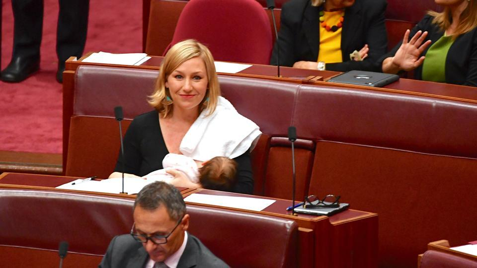 Australian senator Larissa Waters breastfeeds her baby in the Senate Chamber at Parliament House in Canberra.
