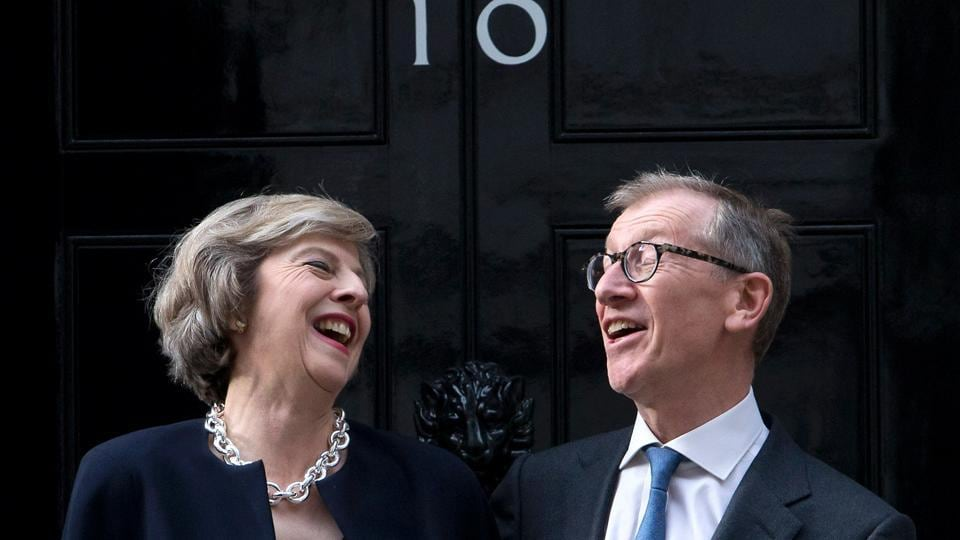 (FILES) This file photo taken on July 13, 2016 shows Britain's new Prime Minister Theresa May (L) and her husband Philip John May posing for a photograph outside the door of 10 Downing Street in central London, on the day that May took office following the formal resignation of David Cameron.
