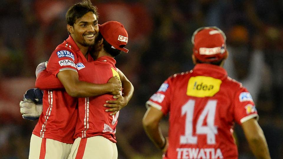 Kings XI Punjab (KXIP) bowler Sandeep Sharma (left) celebrates with wicketkeeper Wriddhaman Saha after picking a Kolkata Knight Riders (KKR) wicket during their Indian Premier League (IPL) match at the Punjab Cricket Association Stadium in Mohali on Tuesday.