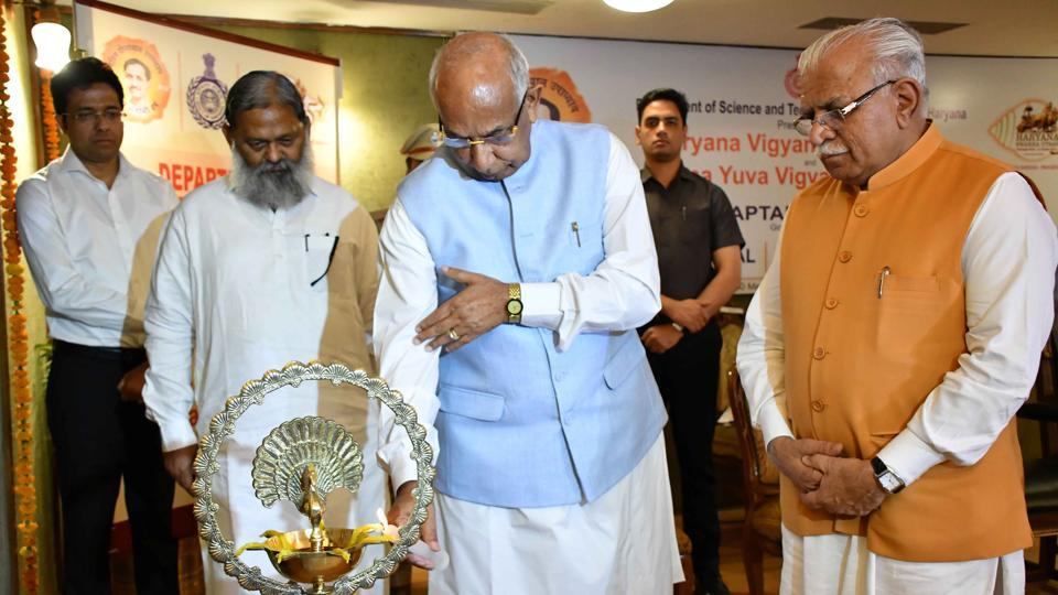 Haryana governor Kaptan Singh Solanki along with Haryana chief minister Manohar Lal Khattar and Science and Technology Minister and Haryana cabinet minister Anil Vij lighting the traditional lamp to inaugurate function to felicitate 11 eminent scientists of Haryana at Haryana Raj Bhavan in Chandigarh on Wednesday.