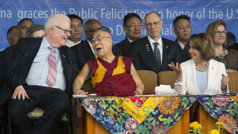 Tibetan spiritual leader the Dalai Lama laughs with Republican Jim Sensenbrenner as Minority Leader in the US House of Representatives Nancy Pelosi (right) looks on in Dharamsala on Wednesday.