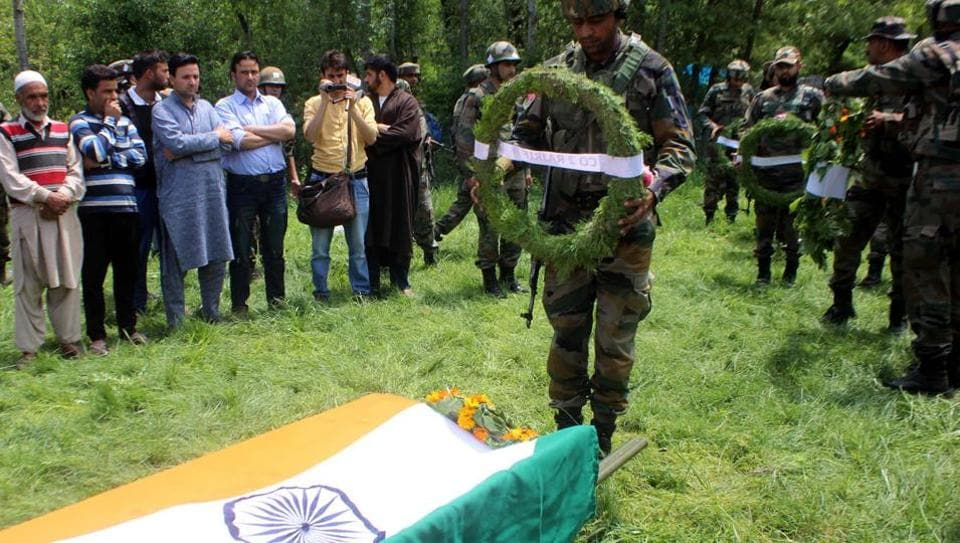 An army soldier pays tribute to their colleague Lt Ummer Fayaz in Kulgam, south of Srinagar.