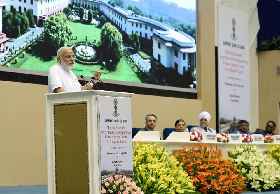 Prime Minister Narendra Modi addresses the event marking introduction of digital filing as a step towards a paperless Supreme Court in New Delhi on Wednesday.