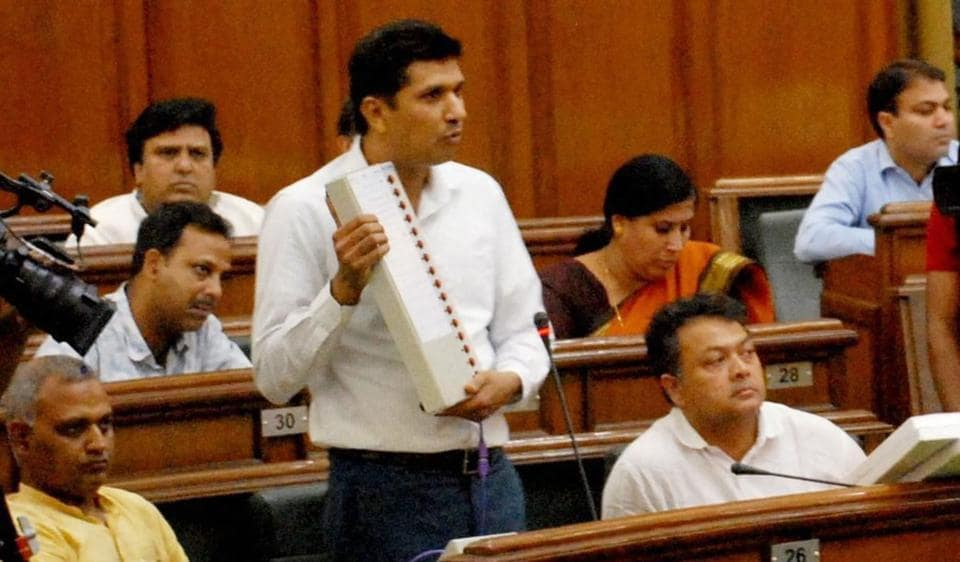 AAP MLA from Greater Kailash with a replica of an EVM in Delhi assembly on May 9.