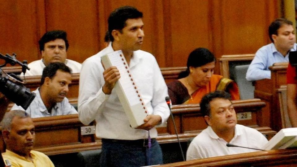 AAP MLA from Greater Kailash Saurabh Bharadwaj demonstrates how an EVM can be manipulated at the special Delhi Assembly session convened by Chief Minister Arvind Kejriwal,on Tuesday.