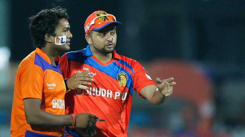 A spectator entered the field and asked for autograph from Gujarat Lions captain Suresh Raina during the Indian Premier League game vs Delhi Daredevils at Green Park in Kanpur on Wednesday.