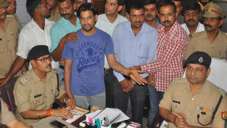 Accused produced by cops at a press conference.