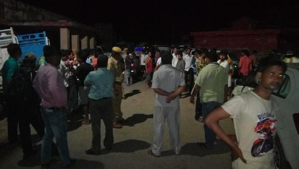 People and police at the site of the wall collapse in Rajasthan's Bharatpur.