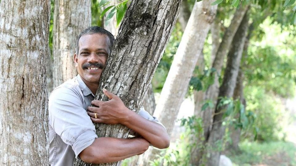 Police inspector V Vidyadharan has been planting trees in two districts of Kerala for the past 40 years.