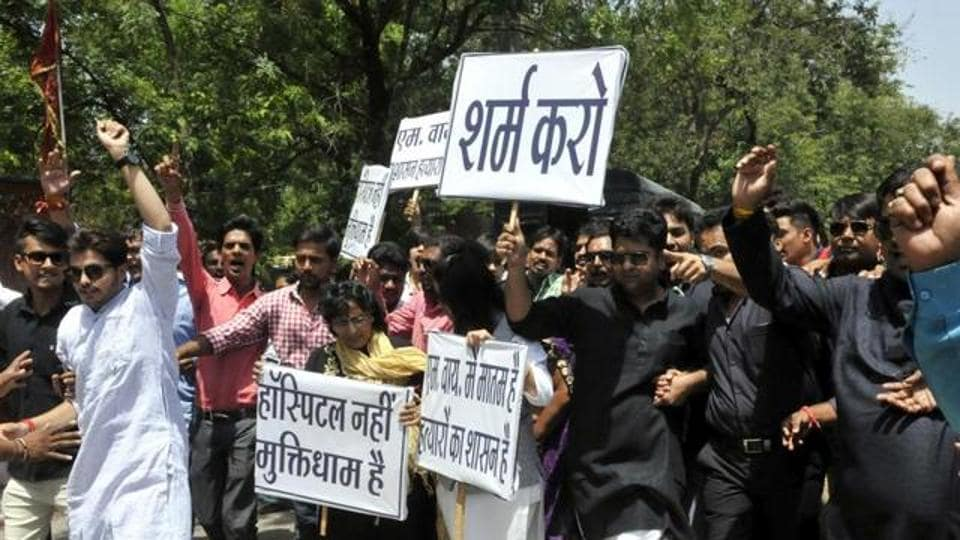 Residents protest against the health minister after the death of a baby at Indore's MY Hospital, in Bhopal.