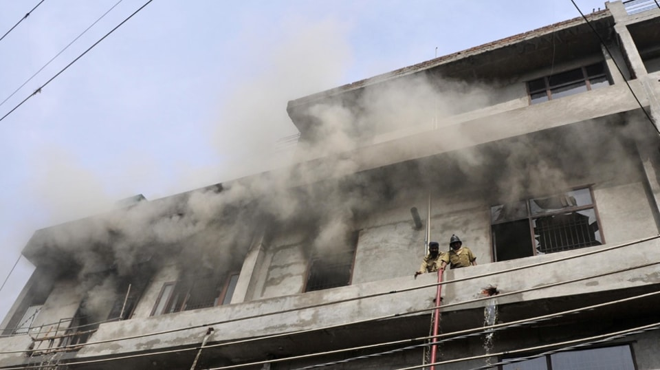 Fire fighters trying to douse fire at the factory in Vijay Nagar on Thursday.