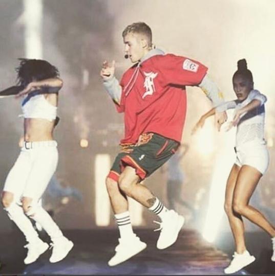 Justin Bieber performing at a concert.