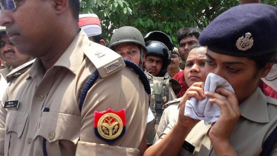 Teary-eyed picture of police officer Charu Nigam after she was publically berated by a BJP MLA Radha Mohan Das Agarwal .