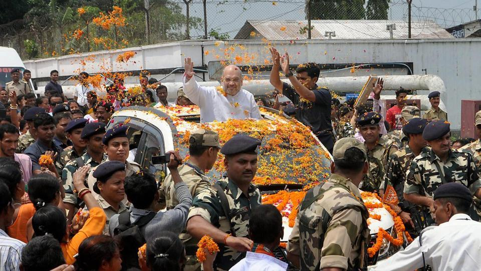 BJP national president Amit Shah waves at supporters as he is welcomed at Agartala airport in Tripura on May 6.