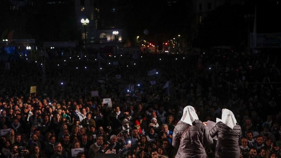 Many wore white headscarves that have become a symbol of the Mothers and Grandmothers of Plaza de Mayo human rights groups. (Emiliano Lasalvia/AFP)
